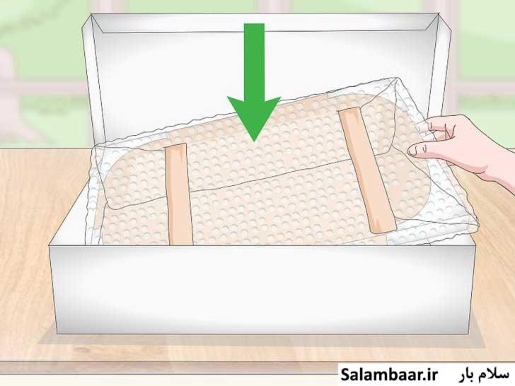 تابلو بسته بندی شده را در جعبه مقوایی قرار دهید